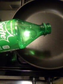 Pouring Sprite Into Pan